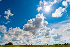 Bright rays of  sun over the yellowed field Stock Photo