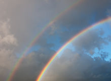 Bright real rainbow sky Stock Images