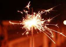 Bright Real Sparkler. With A Construction in The Background Stock Photography