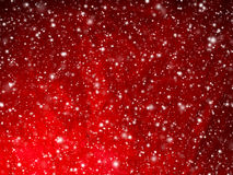 Bright red abstract Christmas background with falling snow. Bright red abstract Christmas background. Winter sky, snowflakes and stars Stock Image