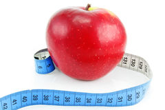 Bright red apple and measuring tape Royalty Free Stock Photography