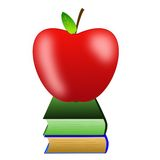 Bright red apple and two books Royalty Free Stock Image