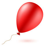 Bright red balloon with rope . Royalty Free Stock Photo