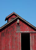 Bright Red Barn. A bright red barn with blue sky background royalty free stock images