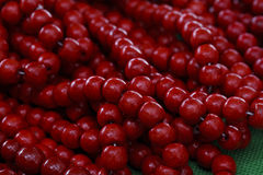 Bright red beads stock photography