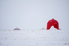 Bright red bee hut. In a white winter landscape Stock Photos