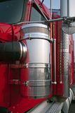 Bright red big rig semi truck close-up view of chrome details an. The technical equipment of big rig semi trucks are given great importance since trucks are the royalty free stock photos