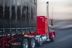 Free Bright Red Big Rig Semi Truck With Covered Semi Trailer Going On The Road For Delivery Stock Photo - 142115350