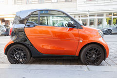 Bright red and black Smart Fortwo car side view Stock Images