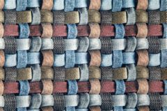 Bright red blue and brown wicker fabric canvas. For upholstery furniture indoor closeup stock images