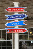 Bright red and blue signs on post at seaside restaurant Royalty Free Stock Photography