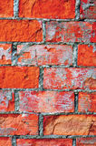 Bright red brick wall texture macro closeup, old detailed rough grunge cracked textured bricks copy space background, grungy Stock Image