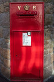 Bright red British post box Royalty Free Stock Image
