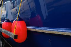 Bright Red Buoys on Boat stock photography