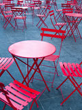 Bright Red Cafe Tables and Chairs. Outside a pavement cafe in Times Square, New York Royalty Free Stock Photography