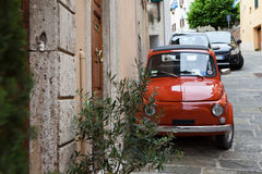 Bright red car on the street of Montepulciano. Italy. Stock Images