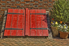 Bright Red Cellar Doors Stock Photo