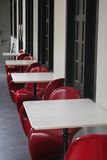 Bright Red Chairs. Bright red and plastic chairs by a hotel alley royalty free stock photo