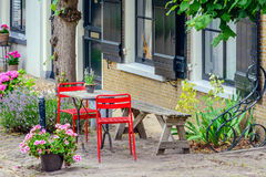 Bright red chairs in front of a historic Dutch house Royalty Free Stock Images