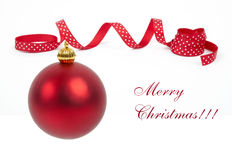 Bright red Christmas tree ball with curly ribbon Royalty Free Stock Photo