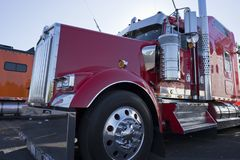 Bright red classic fancy big rig semi truck tractor with chrome. Bright shiny red classic bonnet American fancy big rig semi truck tractor with awesome stylish stock photo