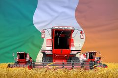 4 bright red combine harvesters on grain field with flag background, Ireland agriculture concept - industrial 3D illustration. Industrial 3D illustration of 4 vector illustration