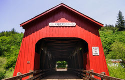 Bright red covered bridge Royalty Free Stock Photography