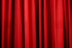 Bright red curtain as a background or texture Royalty Free Stock Photos