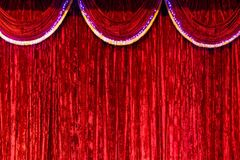Red curtain on stage as background. Bright, Red curtain on stage as background Royalty Free Stock Photo