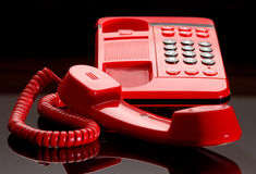 Bright red desk telephone Stock Photos