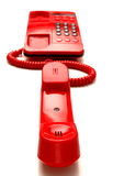 Bright red desktop telephone Royalty Free Stock Photos