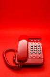 Bright red desktop telephone Stock Image