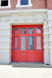 Bright Red Door: Architectural Accent Stock Photo