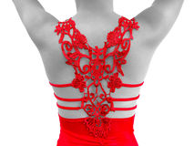 Bright red dress. Closeup back view of an intricate bright red dress on a monochromatic colored model with raised arms, isolated on a white background royalty free stock images