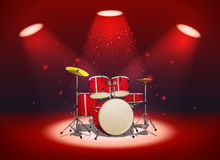 Bright red drum set in the light of spotlights Stock Photos