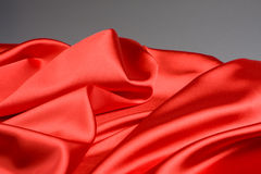 Bright red fabric waves Stock Photos