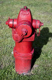 Bright red fire hydrant Stock Photography