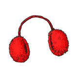 Bright red fluffy fur ear muffs Royalty Free Stock Photo