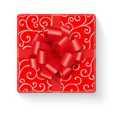 Bright red gift box with curly line pattern. Gift box isolated on white background. Top view. A present wrapped in red wrapping paper with a curly lines pattern Stock Photos