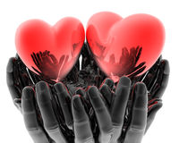 Bright red glass hearts in hands Stock Photo