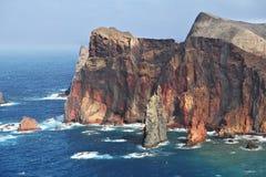 Bright red and gray coastal rocks Royalty Free Stock Photos
