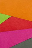 Bright red, green, orange, pink and black paper texture backgrou Stock Photos