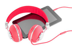 Bright red headphones and black tablet pc Stock Photo