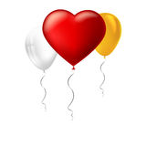 Bright red heart, the inflatable balloon in the shape of a big heart with tape, ribbon and other colored inflatable Stock Photography