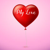 Bright red heart, the inflatable balloon in the shape of a big heart with tape, ribbon. Stock Photo