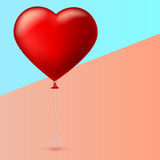 Bright red heart, the inflatable balloon in the shape of a big heart with tape, ribbon. Bright red heart, the inflatable balloon in the shape of a realistic Royalty Free Stock Images