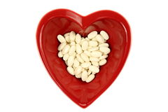 Bright red heart and medicines Stock Photo