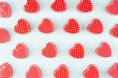 Bright red hearts on mint pastel paper background. Valentine`s day youth design concept art. Bright red hearts on mint pastel paper background. Valentine`s day royalty free stock photos