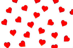 Bright red hearts on a striped background. In order to use Valentine`s Day, weddings, International Women`s Day Stock Photos