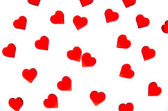 Bright red hearts on a striped background. In order to use Valentine`s Day, weddings, International Women`s Day Royalty Free Stock Image
